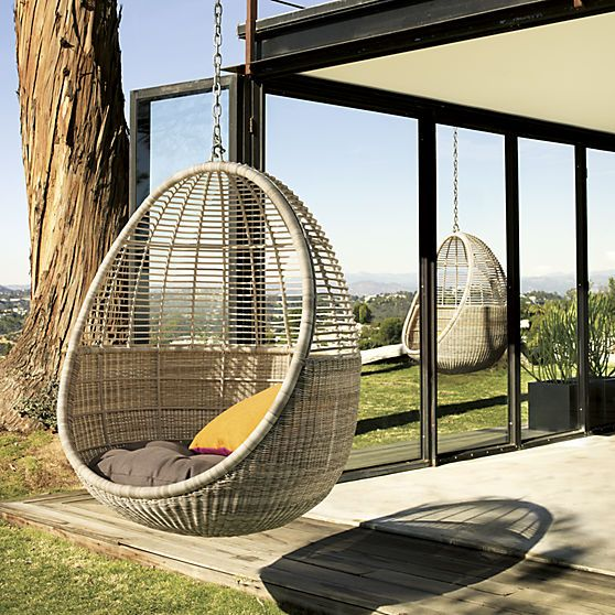 hanging outdoor chairs black leather lounge chair with ottoman pod cb2 mod hang out and hide on the patio in this breezy handwoven seat faux wicker suspend sun drenched home decor