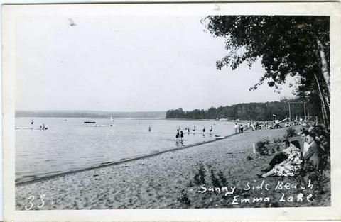 "SASKATCHEWAN | ""Sunnyside Beach Emma Lake"" | A monotone real photo postcard showing Sunnyside Beach at Emma Lake, Saskatchewan"