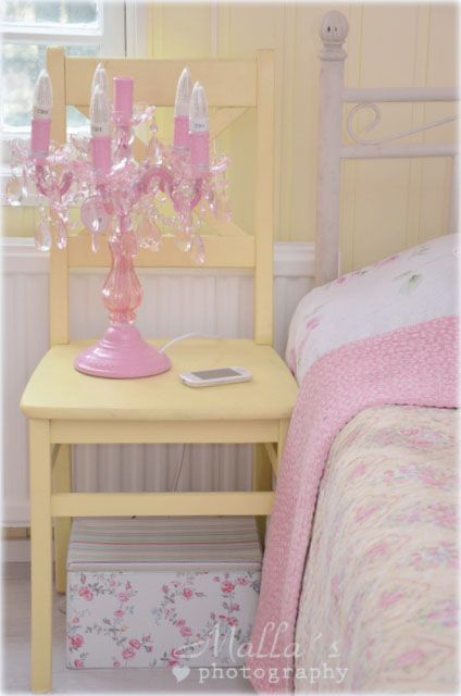 Cottage Style....Love how they used chair as an end table :)