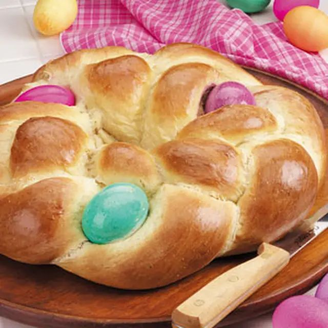 Easter Egg Bread with Sugar, Active Dry Yeast, Ground Cardamom, Salt, All-Purpose Flour, Whole Milk, Butter, Eggs, Eggs, Food Colouring, Canola Oil, Water.