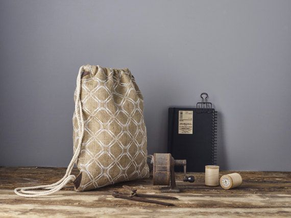 Drawstring Backpack Bohemian bag.  The combination between the jute, the pattern and the modern clean cut, creates a minimalist boho drawstring backpack, youll be happy use every day. Its going to be your favorite bag! Its roomy and comfortable and easy to use - just store your items in the bag, pull the strings to close and wear it on your back. Your hands are free to shop.  This light weight bag is made with 100% natural burlap fabric and with 100% cotton fabric for its lining for great…