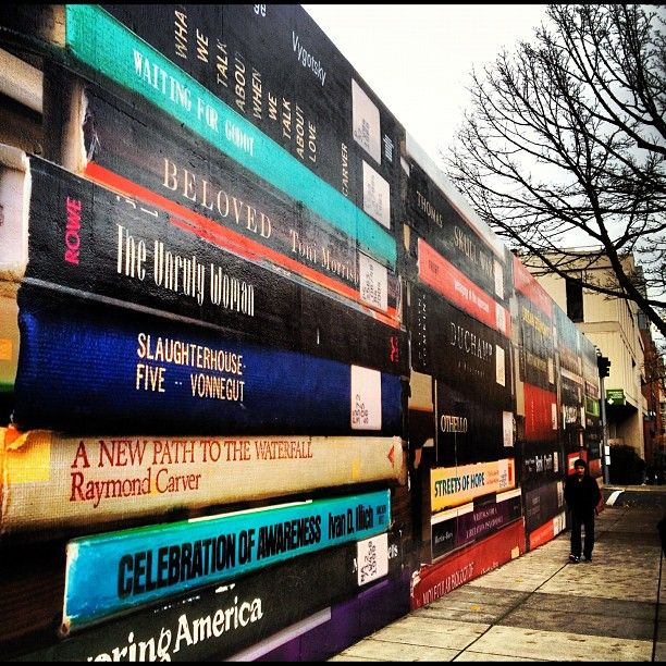 """""""A wall of books in downtown Portland [OR],"""" near Portland State University, from N.Moreau and J.Marfa's cross-country trip. -- Love it!"""