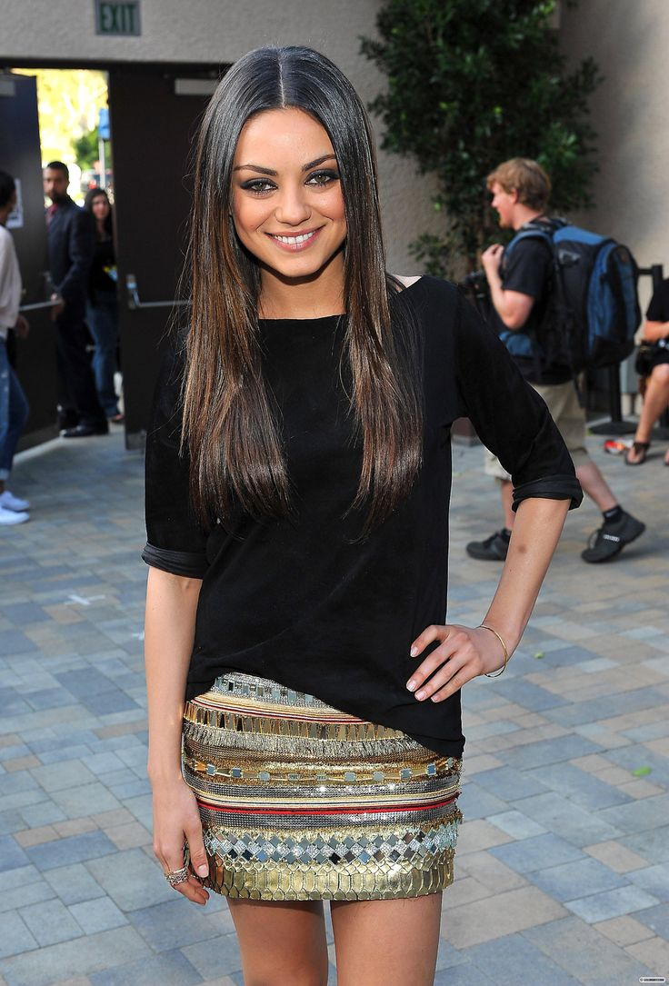 Mila Kunis looking stunning as usual! I love the plain black top with the sequin mini skirt..my style!