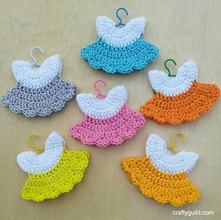 Crocheted_mini_dress...These dresses might actually fit some amigurumi dolls!... Free pattern!