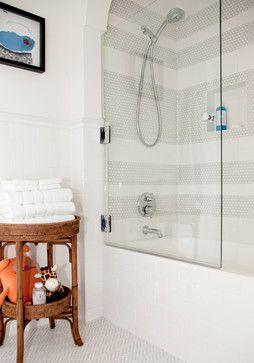 Transitional bathroom.  Ann Sacks Savoy tile on the floor.  Glass shower door created using a 50% ratio to the tub.