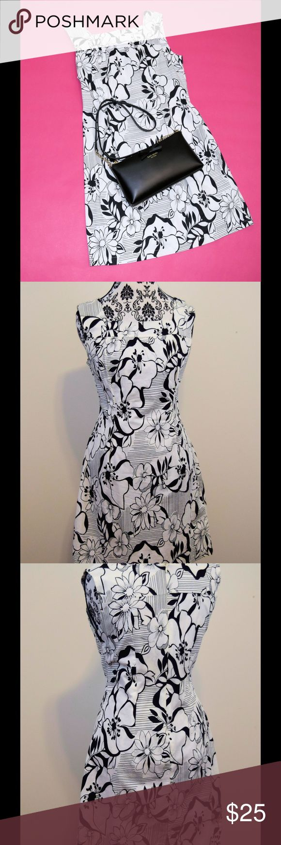 """Black & White Floral Dress Like new! Worn once for only a few hours! Black & white floral pattern sleeveless dress. Flattering square neckline. Size L juniors. Approx. 34"""" length from shoulder. 95% cotton, 5% spandex. Complete the look- purse also available in a separate listing. Bundle the outfit and save 10%! Derek Heart Dresses"""