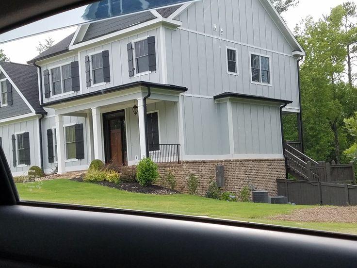 White House Gray Shutters Black Windows