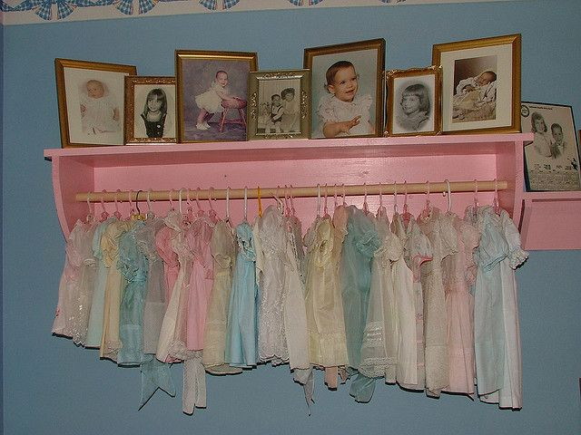 Our guest room, seen here, is decorated with vintage baby dresses and other vintage baby items including family baby portraits starring yours truly!!!