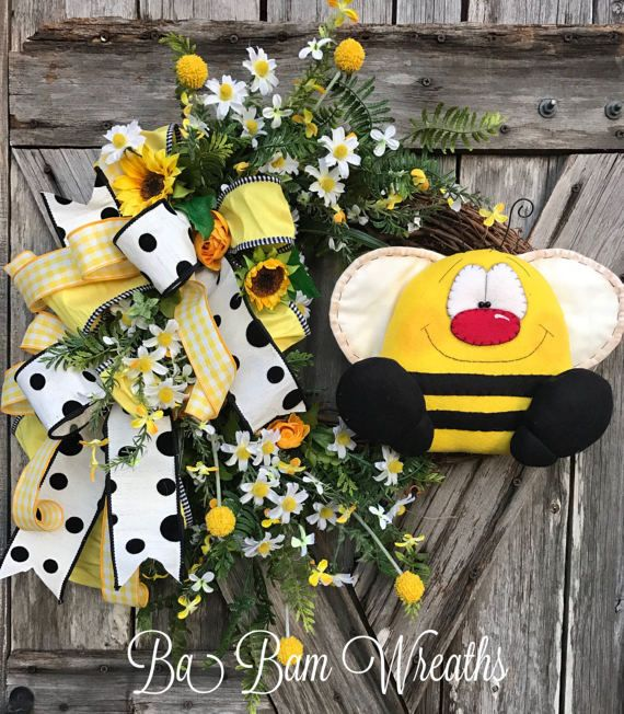 Bee Wreath, Bee Decor, Bee Floral Wreath, Spring Wreath, Spring Decor, Summer Wreath, Everyday Wreath  BEE HAPPY   The colors are vibrant & popping in this wreath and it screams whimsical Fun! Made on a grapevine base and filled with lush greenery, lovely florals, 3 types of designer ribbon~ black & white polka dot~checkered yellow stripped. Stunning yellow roses, dainty daisies, bee sprays and the most precious XL bumblebee ~ who was made by a very talented artist. Measures 25 inches i...