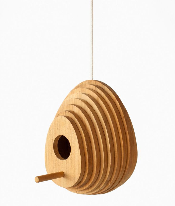 The Tree Ring Birdhouse is an egg-shaped shelter for small birds that mimics the shape of rings found in knots of trees, to make the birds feel at home.