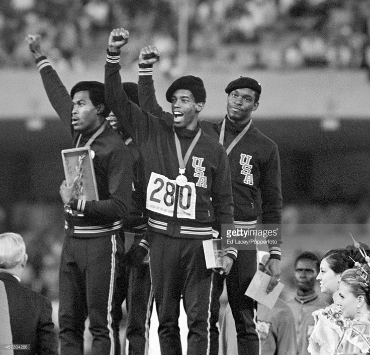 The men's 4x400 metres relay team winners from the United States celebrate their victory during the Summer Olympic Games in Mexico City, circa October 1968. The team comprised Vincent Matthews, Ron Freeman, Larry James and Lee Evans.