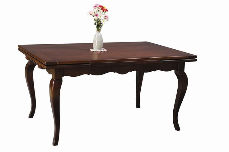 Amish Stowleaf French Country Dining Room Table Relaxed elegance defines the nature of this french country dining table. The stowleaf option keeps table leaves stored right in the ends of the table.