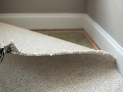 How to Remove Wall-to-Wall Carpet. It's not hard but go carefully so you don't damage the baseboards and take care not to stir up a cloud of dust and allergens that's been collecting through the years.  (Note: the last step shown, take up the old tackstrip, is not usually necessary if you're going to install new carpet, but do remove it if you're choosing a hard-surface flooring.)  Check with your city sanitation department for disposal instructions.