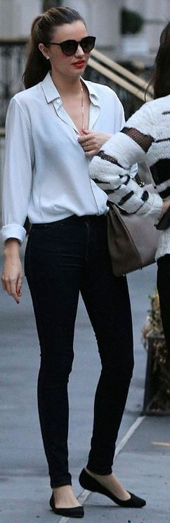 Miranda Kerr - Shoes – Givenchy; Jeans – Nobody; Sunglasses – Stella McCartney; Ring – Anita Ko; Purse – Hermes