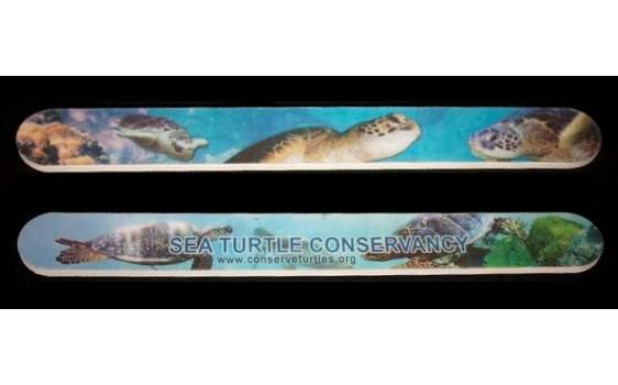 This nail file has images of sea turtles on both sides. It is a fine-medium grit file designed to not tear your nails. The sea turtle image is durable and designed not wear off. It measures approximately seven inches long.
