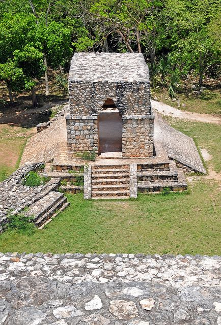 View from atop Palacio Oval (Oval Palace) at Ek Balam, Yucatan, Mexico, of the south entrance and exit to the city, a double-corbel vault with four openings or doorways.