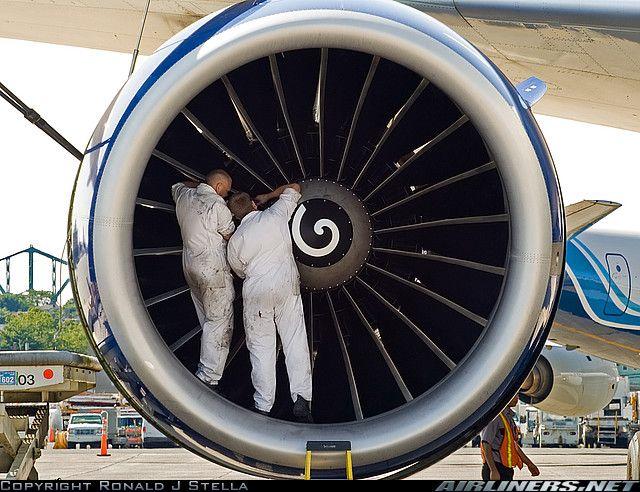 brand new ge90 almost installed mechanics just finishing up the engine swap an unusual turbine engine mechanic