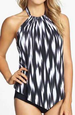 This halter tankini is a perfect choice. Higher necks tend to broaden shoulders and slim waists creating a longer, lean look. The top can also be worn with your favorite shorts or summer skirt.