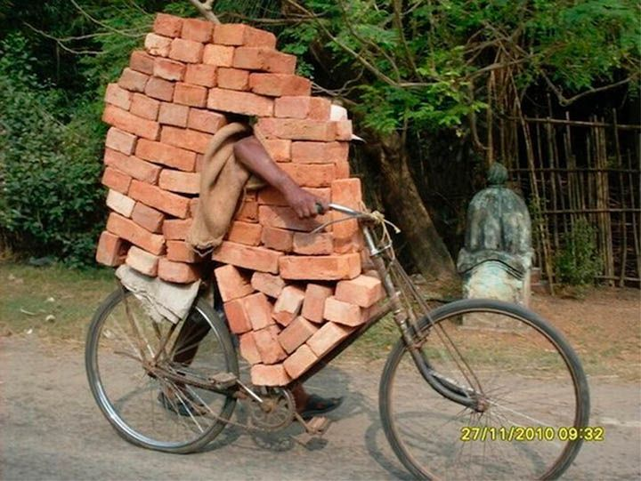Bricks almost hide the man on the other sideMobiles Home, Funny Image, Funny Stories, Create A Boards, Friday Funny, Bricks, Old Bikes, Funny Photos, Funny People