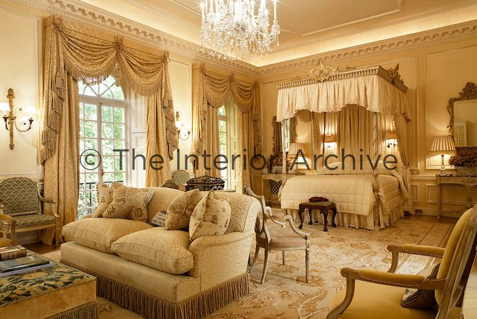 A grand spacious master bedroom with an ornate four poster for 18th century window treatments