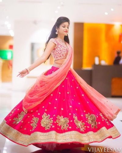 Twirling Brides - Bride in a Georgette Pink Lehenga with Ambi Border Booties and a Light Pink Net Lehenga | WedMeGood Visit www.wedmegood.com for more inspiration. #wedmegood #indianbride #indianwedding #twirling #lehenga #pink