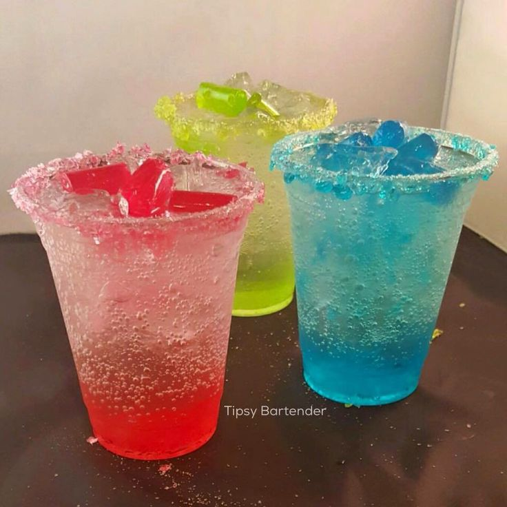 JOLLY RANCHER JEWELS Watermelon: 2 oz. (60 ml) Watermelon Pucker 2 oz. (60 ml) Smirnoff Watermelon  Green Apple: 2 oz. (60 ml) Green Apple Pucker 2 oz. (60 ml) Smirnoff Green Apple  Blue Raspberry: 2 oz. (60 ml) Island Punch Pucker 2 oz. (60 ml) Smirnoff Raspberry Top with Sprite Mixed w Crushed Jolly Rancher Pieces. Jolly Rancher Rim: Crushed Jolly Rancher and Corn Syrup