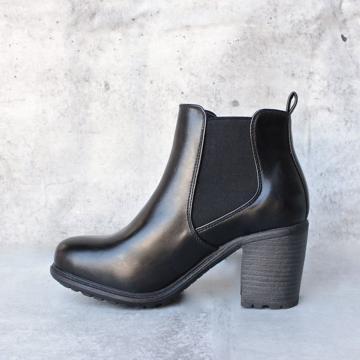 Chic pair of black faux leather Chelsea-style ankle boots. Elastic on both sides of ankle for easy wear. Rugged Rubber sole. Stacked heels. - imported - size up .5 size if in between sizes, runs sligh