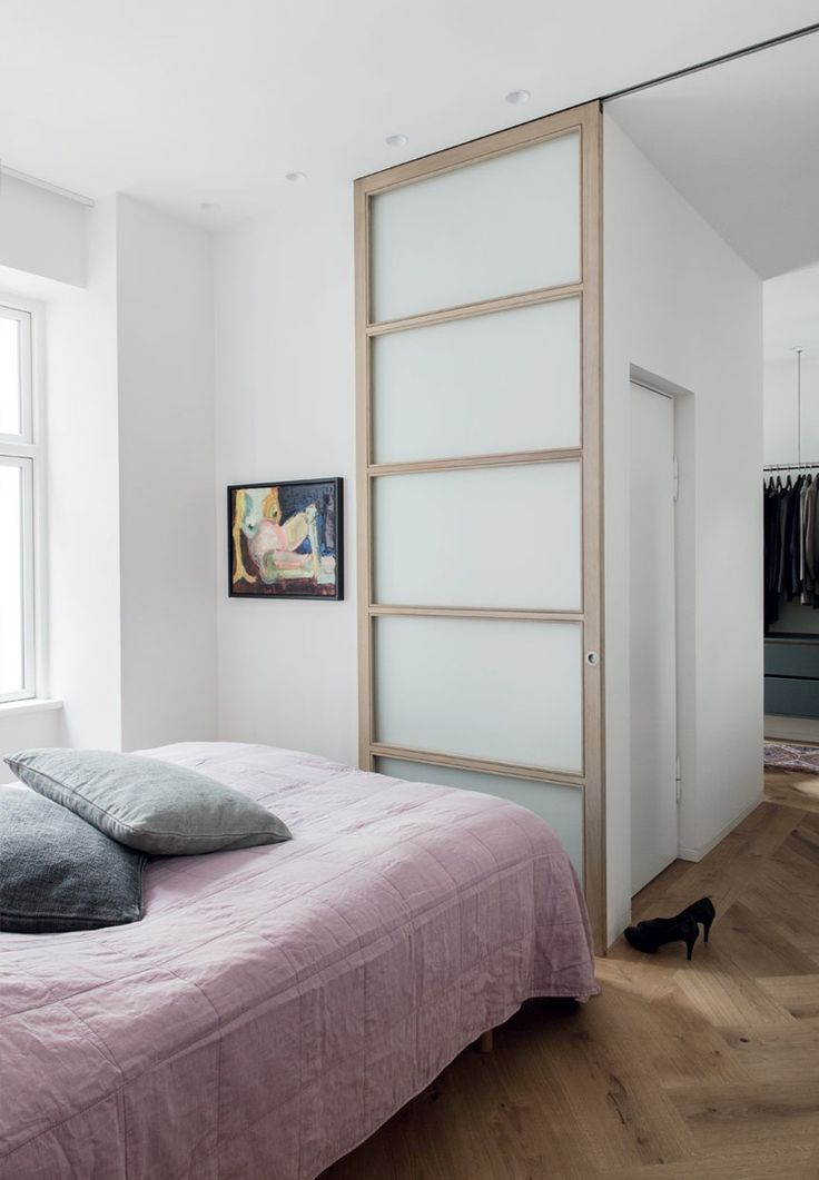 simple bedroom with a sliding door into the walk in closet