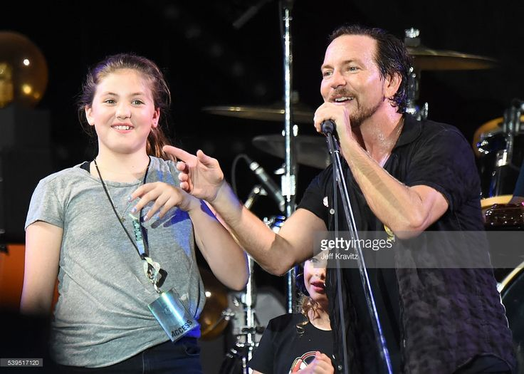 Recording artist Eddie Vedder (R) of Pearl Jam performs Happy Birthday to Olivia Vedder (L) with Harper Vedder (C) onstage at What Stage during Day 3 of the 2016 Bonnaroo Arts And Music Festival on June 9, 2016 in Manchester, Tennessee.