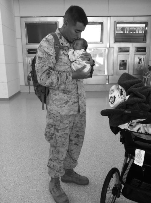 I love these pictures with the men in the military coming home to their new born babies.