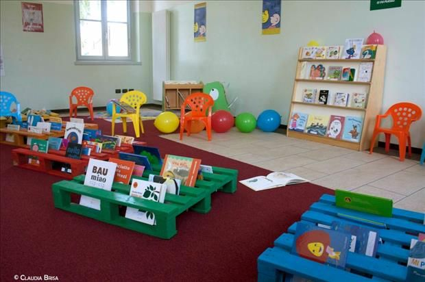 28 Amazing Uses For Old Pallets...pallets as daycare amusements...sanded and painted...can be used as shown, propping up books for story time and as seating, stacked to make forts or boats...