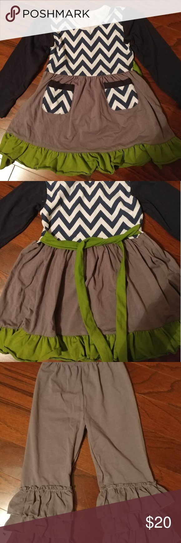 Brand new Boutique outfit Very cute outfit. Chevron print with Chevron pockets and green bottom Ruffle. Has a green tie that ties in the back. Gray 3 tiered Ruffled pants. Size Small but fits Size 2-3. Matching Sets