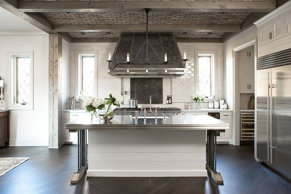 Love the hood,..exposed wood,..zinc countertop.. neat kitchen