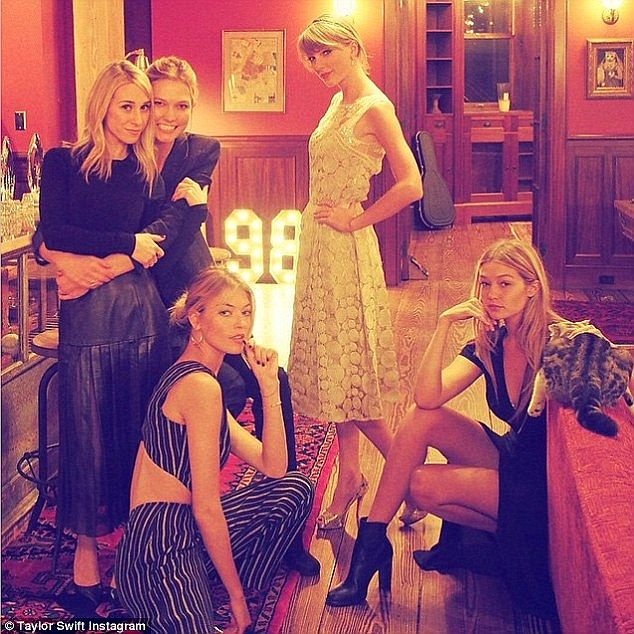 Karlie Kloss, second from right, Martha Hunt and Gigi Hadid join Taylor for dinner