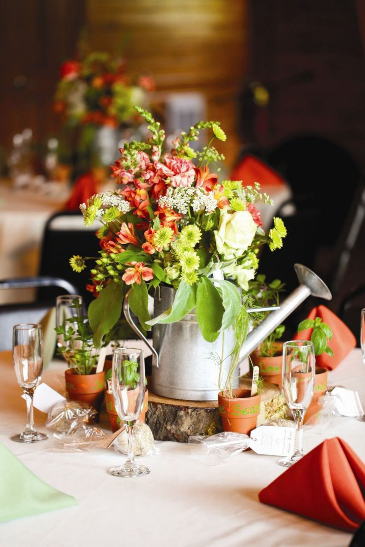 17 best ideas about watering can centerpieces on pinterest for Where can i find wedding decorations
