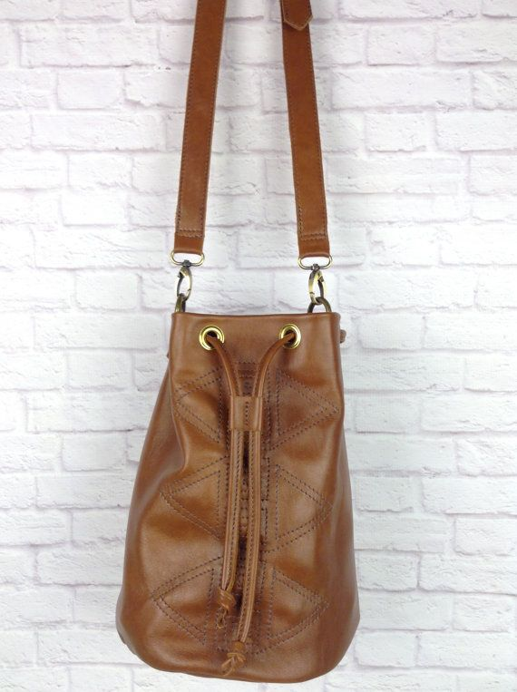brown leather bucket bag with geometric decorative stitching by Wolf Blossom