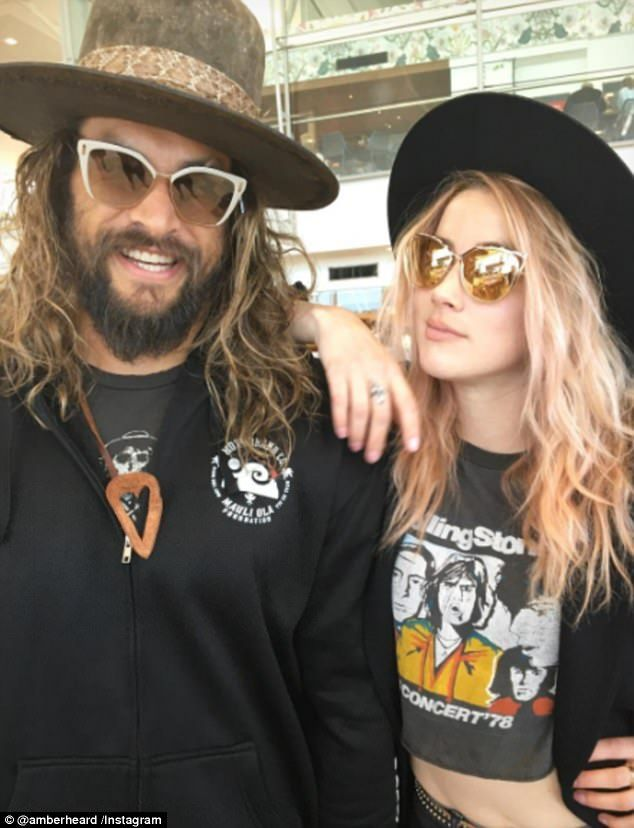 "#DailyMailUK .... "" 'Undercover Down Under': On Monday, Amber Heard and Aquaman co-star Jason Momoa posed up for a fun snap on Instagram, hiding their famous faces in sunglasses and hats."".... http://www.dailymail.co.uk/tvshowbiz/article-4462400/Amber-Heard-flashes-toned-stomach-Jason-Momoa.html"
