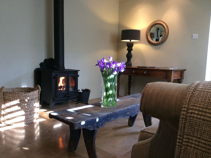 The tranquil sitting room with wood-burning stove.