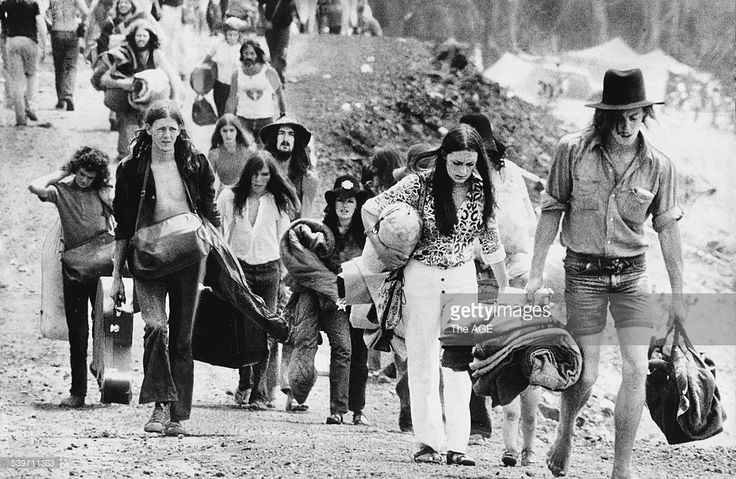 Fans leave the Sunbury Music Festival carrying their belongings at the end of the festival, 14 February 1972. Victoria Australia THE AGE Picture by STAFF