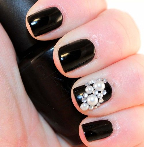 I like having one pearl nail as an accent. Also the white on black is so pretty.