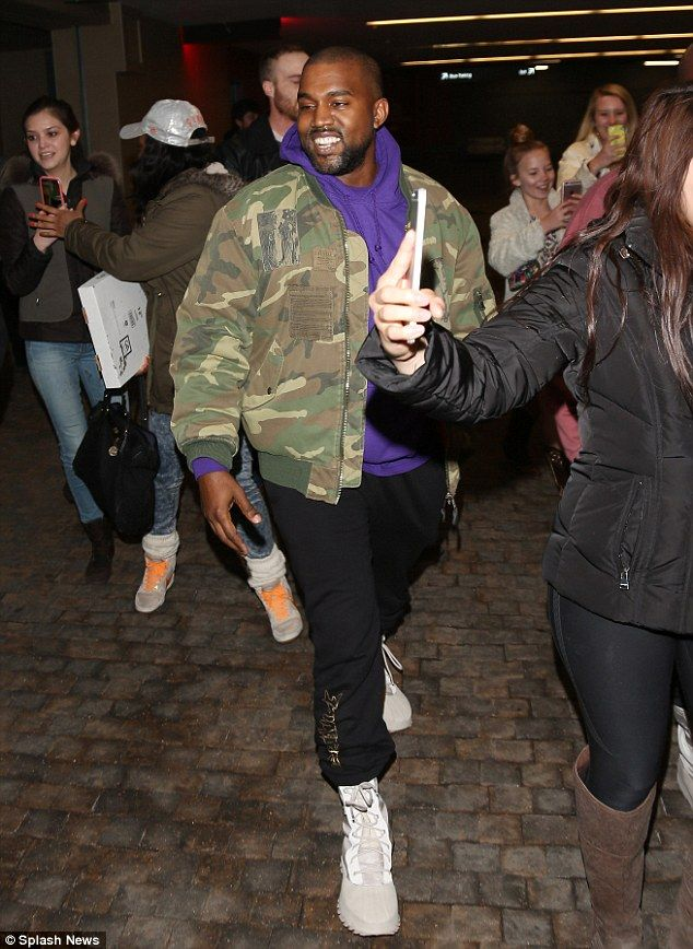 Showing his style: The 38-year-old rapper sported a camouflage jacket over
