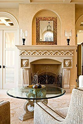 Italian style decor sitting room with a stately fireplace.  Mosaic sun-catching wall mirror from DecorShore.