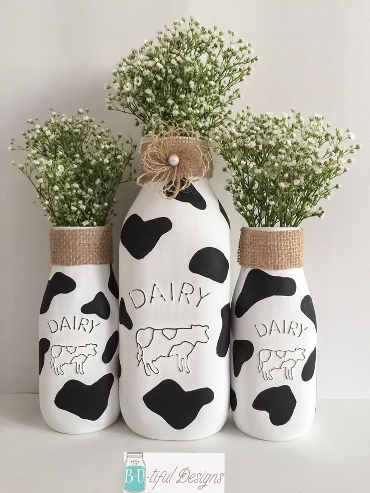 A personal favorite from my Etsy shop https://www.etsy.com/listing/235127533/cow-kitchen-theme-milk-bottles (Milk Bottle Decoration)