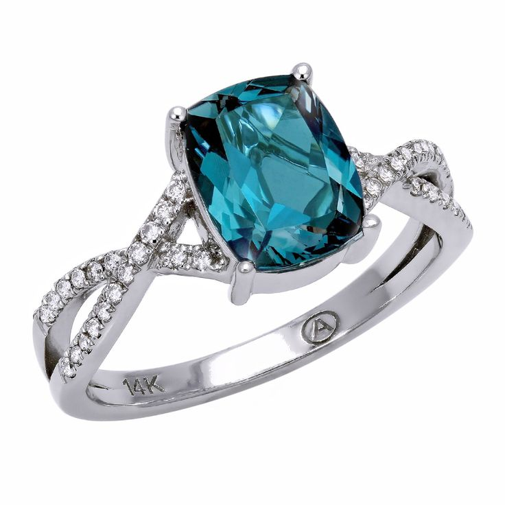 Gorgeous ring crafted in 14k white gold and featuring one luxurious cushion shape london blue topaz center gemstone with criss-cross white diamonds on the sides. This elegant jewelry is crafted with a