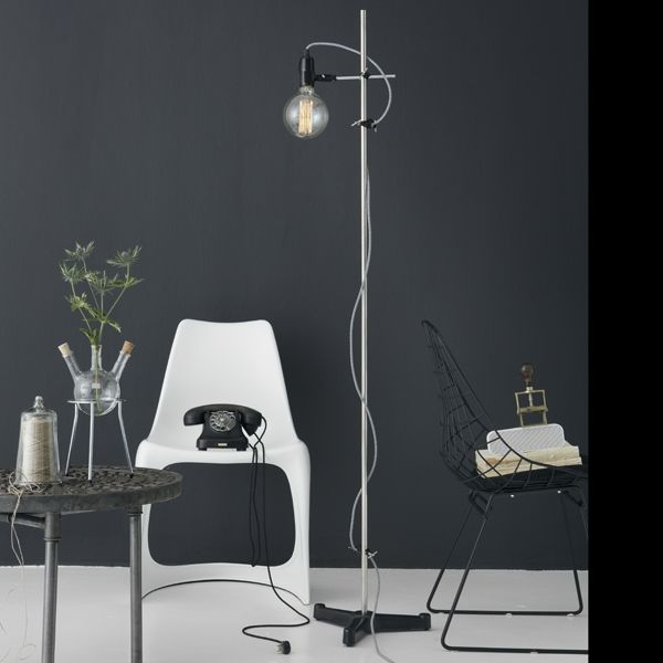 RØMER Industrial floor lamp with large globe bulb. The components are original lab-equipment and have the flexibility and solid quality that characterizes lab-equipment.Choose between 6 different colors of cable and 2 types of globe bulbs Contains: Black cast iron base: Ø380 Chrom center rod: ø16 × 1600 3 pcs. bosshead 1 pc. tripod clamp Fabric cable with switch, 3 meters ø125 GLOBE light bulb 40W Comes in a gift box  CE approved  www.kemikaze.dk Picture credits: Eckmannstudio