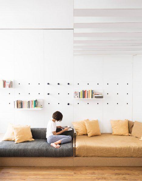 Fold-out furniture and storage solutions transform Silvia Allori's home into a studio