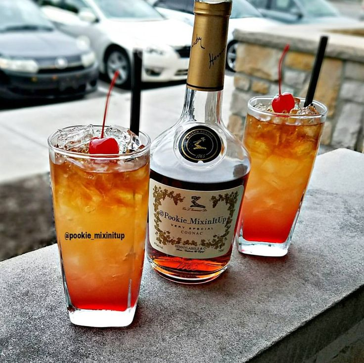 Tropical Henny Cyclone  Raspberry Syrup, Pineapple Peach Lemonade, Mango Tequila & Hennessy topped with Cherry  #pookiemixinitup #cocktail #cocktails #cocktailporn #drinkgasm #drinkporn #mixology #cognac #hennessy #hennygang #henny #hennycolada #darkliquo