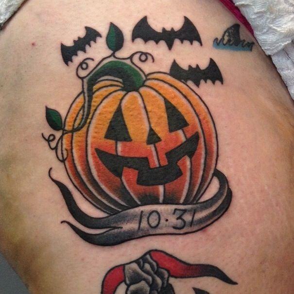 Pumpkin and bats Halloween dedication tattoo.