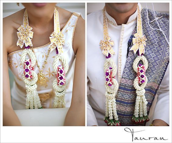 Check out these amazing thai flower Jaimalas with ribbons atop! Simply stunning this and more ideas on the perfect Jaimala @Wittyvows - www.wittyvows.com Click the image to read more