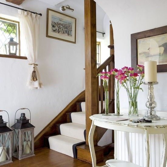 In This Farmhouse style Hallway Painted Furniture And A Neutral Stair
